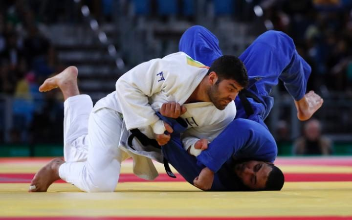 Or Sasson of Israel (L) and Islam El Shehaby of Egypt (R) in action in the men's +100kg bout of the Rio 2016 Olympic Games  CREDIT: EPA