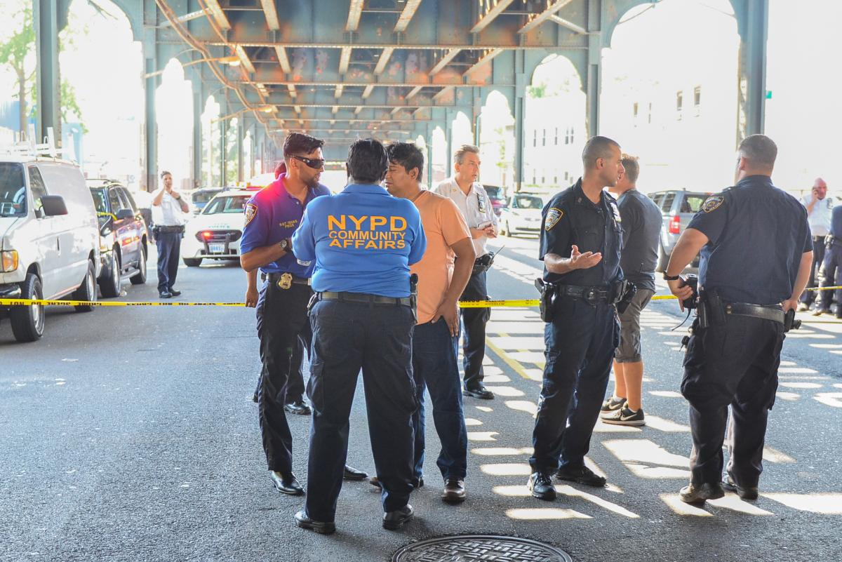 The two men were shot on 79th St. near Liberty Ave. about 1:50 p.m., officials said. First responders rushed the pair to Elmhurst Hospital. (David Wexler/For New York Daily News)
